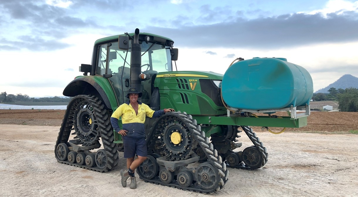 Jason Dipple with the 6105M tractor at Pinata Farms, Wamuran, Sunshine Coast