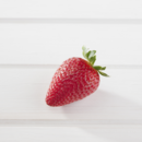 A single fresh Pinata strawberry